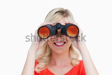 Mujer mirando binoculares sonriendo blanco cara Foto stock © wavebreak_media