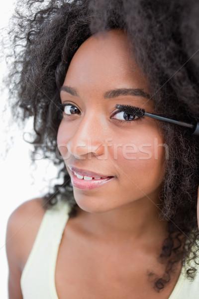 Uśmiechnięty młoda kobieta czarny tusz do rzęs biały Zdjęcia stock © wavebreak_media