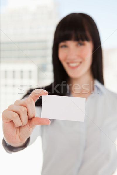 A focused shot on the business card as it is held by a business woman Stock photo © wavebreak_media