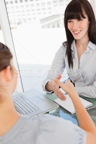 Both women get ready to shake hands by moving their hands closer together Stock photo © wavebreak_media