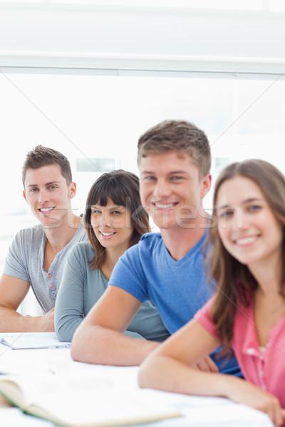 Vista lateral tiro sorridente estudantes olhando Foto stock © wavebreak_media