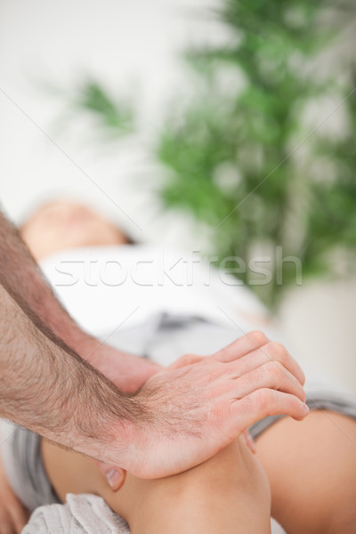 Serious doctor pressing on the knee of a woman indoors Stock photo © wavebreak_media