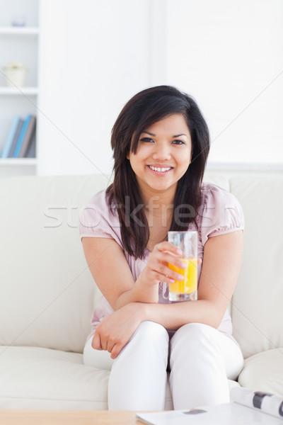 笑顔の女性 座って ガラス オレンジジュース リビングルーム ストックフォト © wavebreak_media