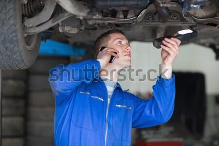 Woman hugging a grey car in a car dealership Stock photo © wavebreak_media