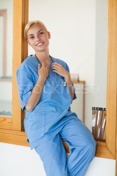 Enfermeira sessão recepção secretária hospital madeira Foto stock © wavebreak_media
