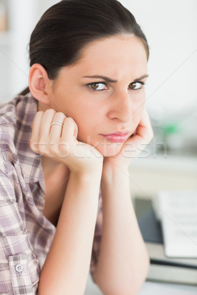 Upset woman looking at camera in a living room Stock photo © wavebreak_media