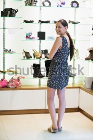 Woman standing beside shoe display in shopping mall Stock photo © wavebreak_media