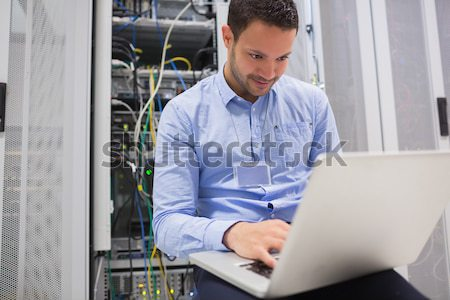 Data centre worker with tablet computer in data centre Stock photo © wavebreak_media