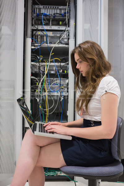 Woman using laptop in front of servers in data center Stock photo © wavebreak_media