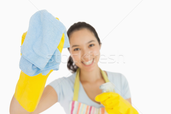 Laughing woman wiping with a blue rag wearing rubber gloves and apron Stock photo © wavebreak_media