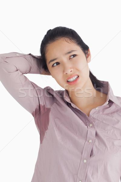Vrouw zweten vrouwelijke shirt witte achtergrond Stockfoto © wavebreak_media