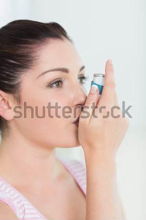женщину астма рот женщины кавказский белом фоне Сток-фото © wavebreak_media