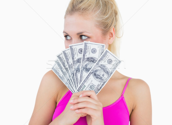 Woman with fanned us banknotes looking away Stock photo © wavebreak_media
