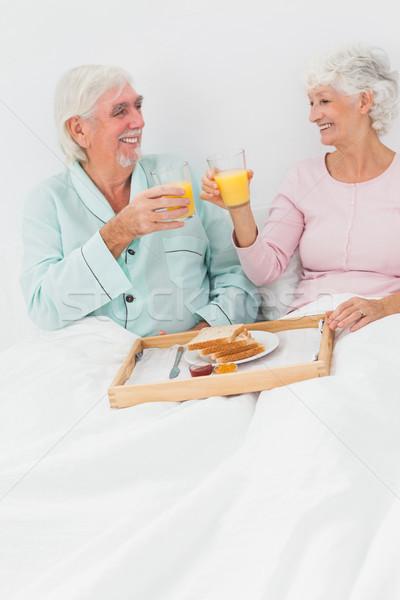 пару завтрак кровать пожилого человека счастливым Сток-фото © wavebreak_media