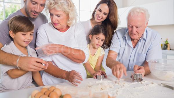 Multi-generation family baking together Stock photo © wavebreak_media