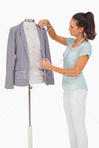 Fashion designer measuring blazer lapel on mannequin Stock photo © wavebreak_media
