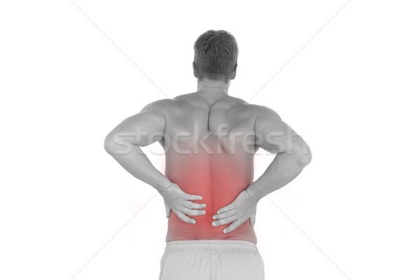 Shirtless man suffering from lower back pain Stock photo © wavebreak_media