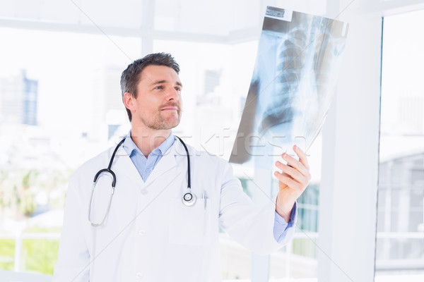 Serious male doctor examining xray Stock photo © wavebreak_media