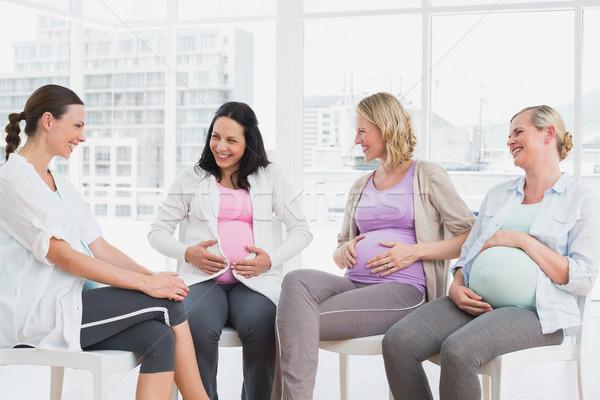 Happy pregnant women talking together at antenatal class Stock photo © wavebreak_media