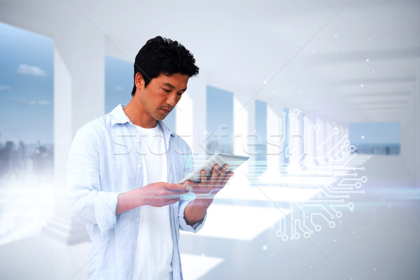 Casual man using tablet with circuit board Stock photo © wavebreak_media