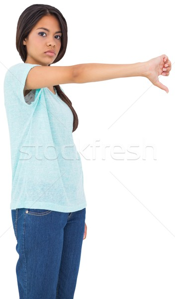 Disappointed brunette giving thumbs down Stock photo © wavebreak_media