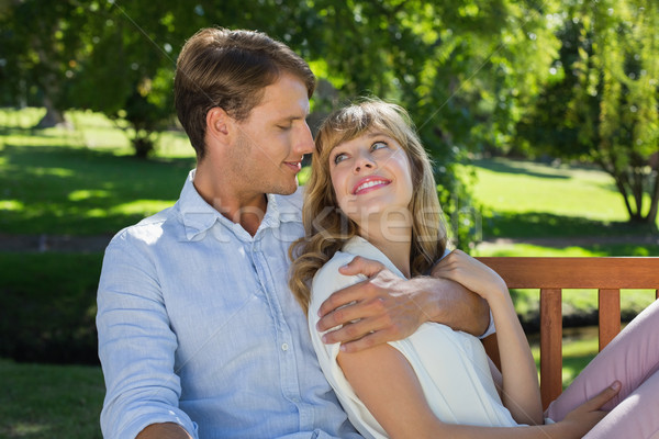 Affectionate couple relaxing on park bench together smiling at e Stock photo © wavebreak_media