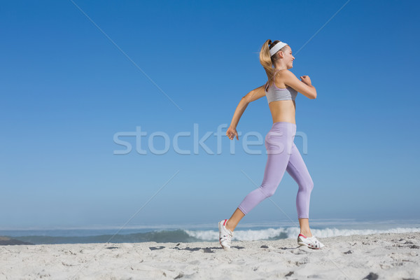 Sporty blonde on the beach jogging Stock photo © wavebreak_media