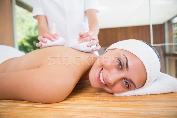 улыбающаяся женщина назад массаж травяной счастливым Сток-фото © wavebreak_media