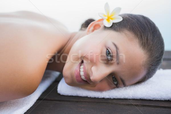 мирный брюнетка полотенце улыбаясь камеры за пределами Сток-фото © wavebreak_media