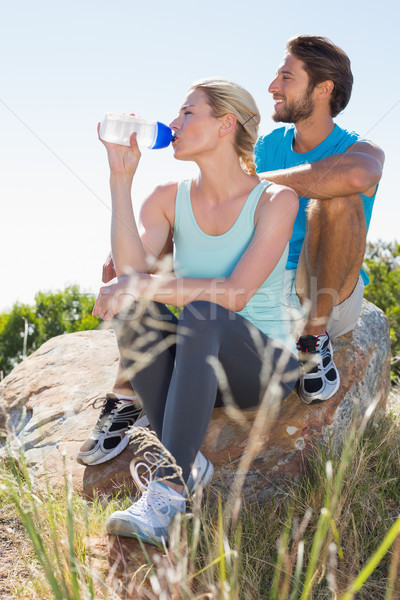 Fit couple taking a break at summit looking at the view Stock photo © wavebreak_media