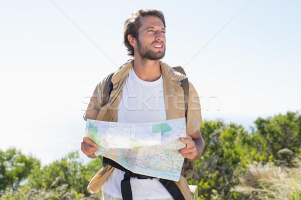 Handsome hiker holding map on mountain trail Stock photo © wavebreak_media