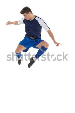 Football player in blue kicking and jumping Stock photo © wavebreak_media