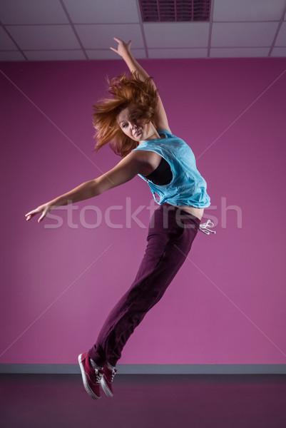 Pretty break dancer leaping mid air Stock photo © wavebreak_media