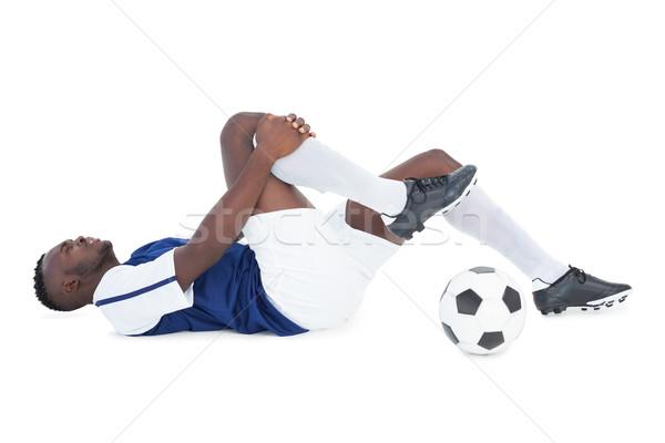 Football player lying down injured Stock photo © wavebreak_media