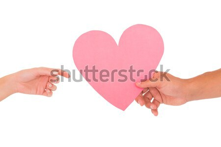 Couple passing a paper heart Stock photo © wavebreak_media