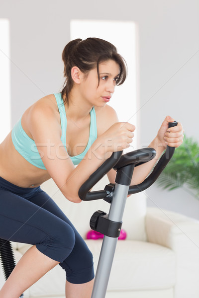 Fit brunette working out on exercise bike Stock photo © wavebreak_media