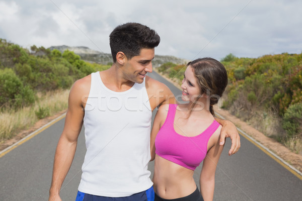 Fit couple standing on the open road Stock photo © wavebreak_media