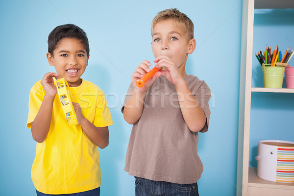 Cute peu garçons jouer instruments de musique classe Photo stock © wavebreak_media