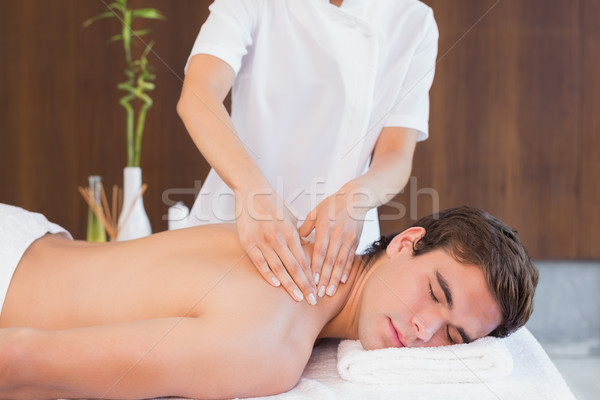 Man receiving back massage at spa center Stock photo © wavebreak_media