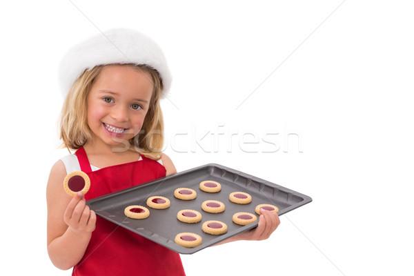 Kleines Mädchen halten frischen Cookies weiß Stock foto © wavebreak_media