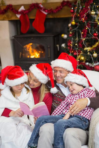 Happy family reading at christmas Stock photo © wavebreak_media