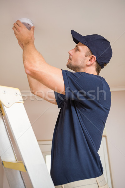Handyman installing smoke detector Stock photo © wavebreak_media