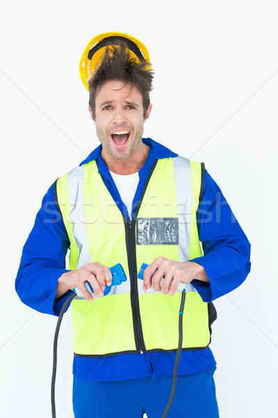Electrician getting a shock while holding wires Stock photo © wavebreak_media