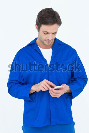 Mechanic text messaging on mobile phone Stock photo © wavebreak_media
