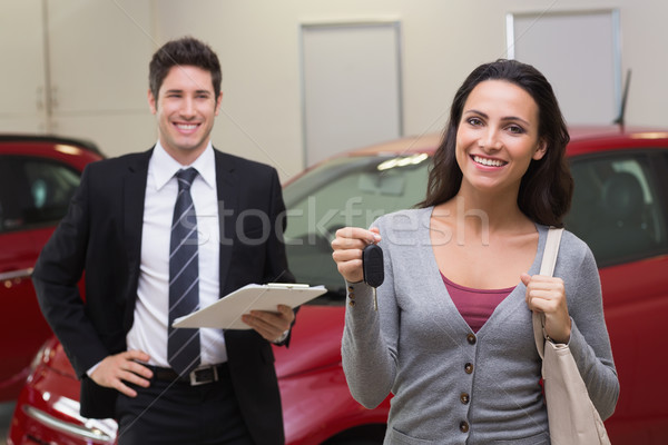 Female driver showing a key after bying a new car Stock photo © wavebreak_media