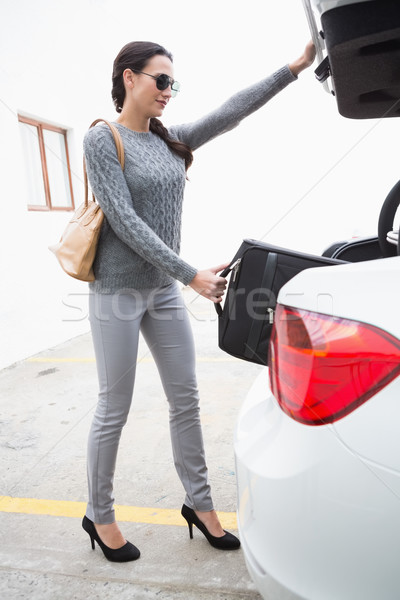 Woman pulling out a baggage of her car trunk Stock photo © wavebreak_media
