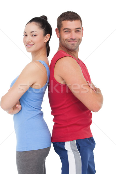 Fit man and woman smiling at camera together Stock photo © wavebreak_media