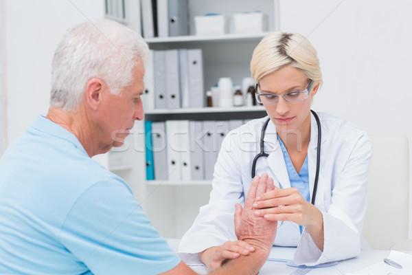Kobiet mężczyzna nadgarstek kliniki kobieta Zdjęcia stock © wavebreak_media