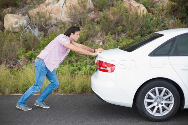 Man pushing car after a car breakdown  Stock photo © wavebreak_media