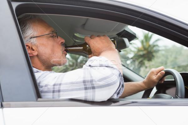 Adam içme bira sürücü araba şişe Stok fotoğraf © wavebreak_media